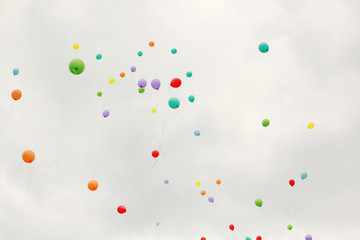 Balloons floating to sky