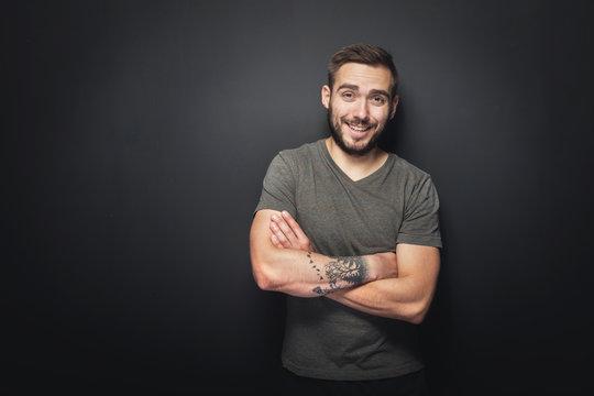 Joyful, handsome man on a black background