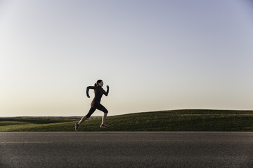 A woman running on a road