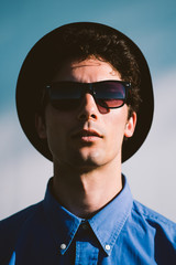 Portrait of a Young Man Wearing Sunglasses