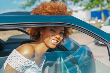 Latin American Afro Woman Getting out of the Car