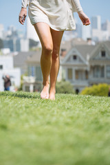 Girl walking barefoot in the park