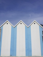 Blue and white bathing houses on the beach