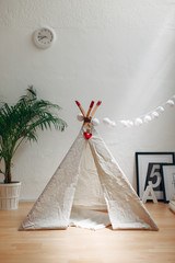Cute handmade teepee in a room.