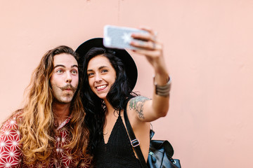 A man and a woman taking a selfie photo together