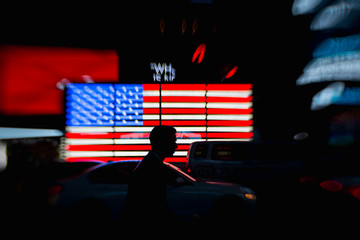 Silhouette of a man with the American flag in the background