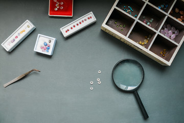 Gemstones and Magnifying Glass on the Table