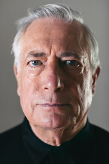 Portrait of an elderly man looking at camera.