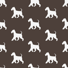Seamless pattern with white silhouettes of terriers.