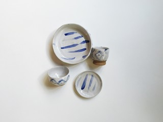 Hand painted and handmade white glazed pottery with indigo aztec pattern design