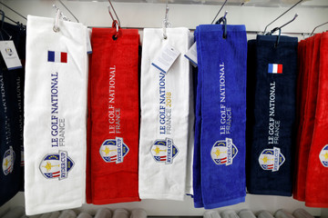 Towels with the 2018 Ryder Cup logo are displayed for sale at France's Golf National where the Ryder Cup 2018 tournament will be held at Saint-Quentin-en-Yvelines