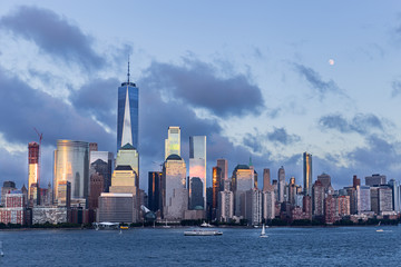 Fototapete - Lower Manhattan Skyline and moon rising at blue hour, NYC, USA