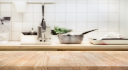 Wood table top on blur kitchen room background .For montage product display or  key visual layout. Wall mural