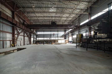 A large empty factory building.