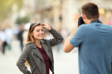 Photographer photographing a model on the street