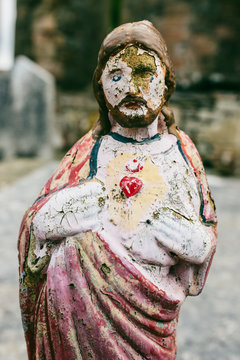 Jesus figurine in an old cemetery
