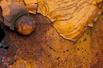 closeup macro macrophotograph rust patterns on steel trains in rainstorm paint deterioration
