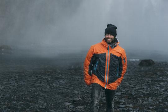 Man exploring waterfall in Iceland