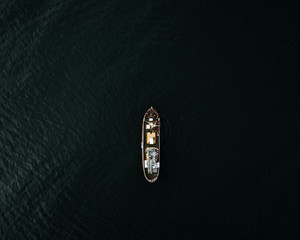 Aerial of a Ship standing still in the dark ocean