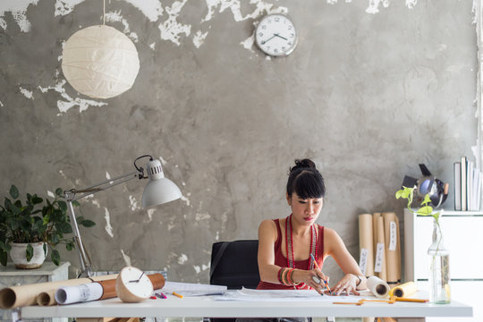 Asian female architect working from home