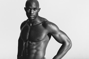 Strong afro-american man showing off his physique