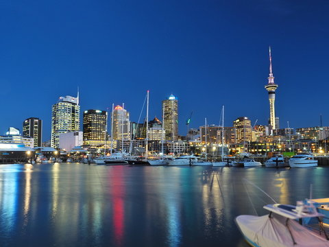 Night view of Auckland City and the Sky Tower from the harbor. (North Island, NZ)