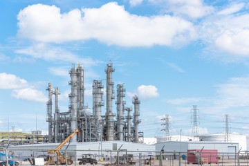 Oil refinery, oil factory, petrochemical plant in Pasadena, Texas, USA under cloud blue sky.