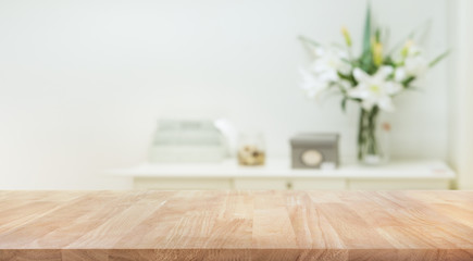 Real wood table top texture on white wall room background.For create product display or key visual layout