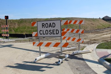 The road closed sign near a construction site.