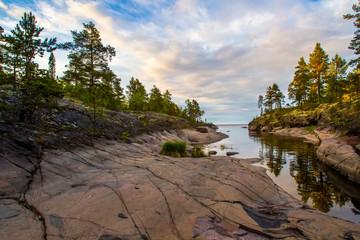 Sunny morning. Long rocks. Russia. Karelia. Ladoga lake.