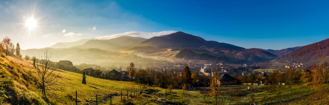 panorama of Volovets town in Carpathian mountains. gorgeous foggy sunrise with Magnificent Borzhava mountain ridge in a distance. beautiful countryside landscape in autumn