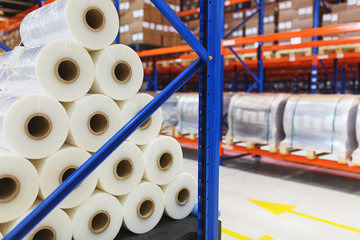 system of address storage of products, materials and goods in a warehouse. Rolls of polyethylene film in stock.