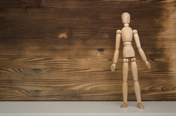 Guilty wooden man doll shrug their shoulders on wooden background with copy space. No results. Not found.