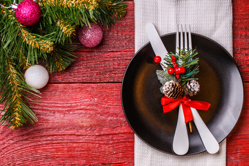 Image of Christmas table with fork and knife on plate