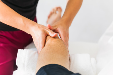 Therapist Giving Leg Massage In Spa manipulation of a calf muscle