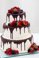 chocolate white wedding cake with fruit strawberry three floor