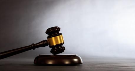 Judge or auction gavel on a dark background