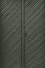 Double doors with diagonal bead board details