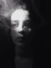 Young beautiful woman smoking