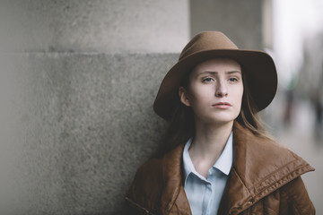 woman with hat on the street