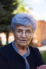 Portrait of an old woman with grey hair