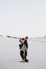 Cute couple standing in the middle of dried riverbed