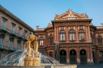 Landmarks of Catania: night view of the fountain of Dolphins in Piazza teatro Massimo, and a view of the Bellini theater