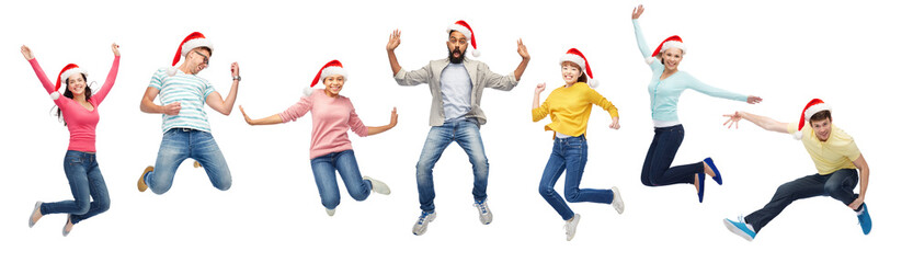 happy people in santa hats jumping in air