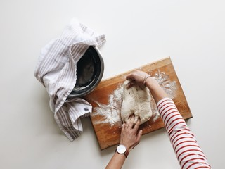 Overhead image of someone kneading dough