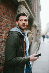 Young man using a smartphone in the street