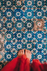 Woman Barefoot Standing On Aged Tiles Floor
