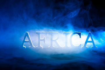 Africa. Smoke. The inscription Africa in the fog.