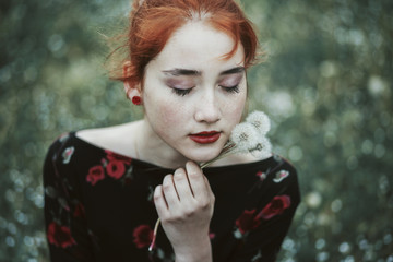 Portrait of a beautiful ginger haired woman with freckles