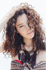 Portrait of a curly hair young woman